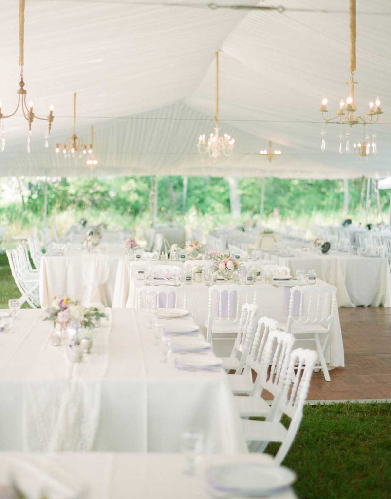 A gorgeous tented wedding reception in the backyard of the farmhouse | A Country Chic Wedding With Stunning Vintage Details