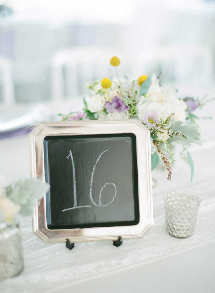 Table numbers on chalkboards | A Country Chic Wedding With Stunning Vintage Details