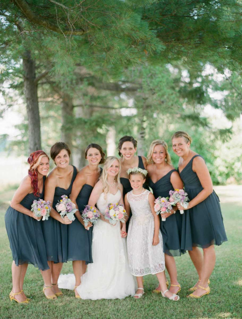 The girls wore one-shoulder charcoal bridesmaid dresses | A Country Chic Wedding With Stunning Vintage Details