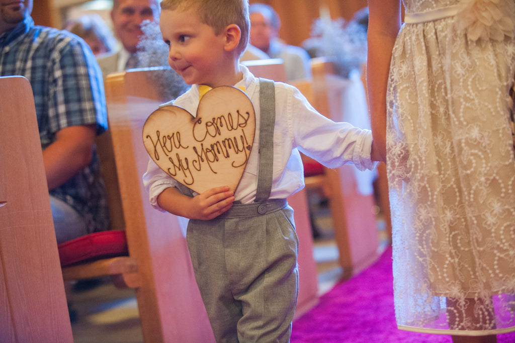 Adorable photo of the ring bear getting excited for his mom to walk down the aisle! | 52 Best Wedding Photo Ideas | Kennedy Blue | Emily Steffan Photography