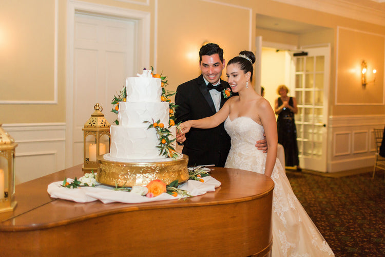 Cutting the cake at reception | Alexis and Michaels Wedding | Featured on Destination Wedding Details | Real Wedding blog