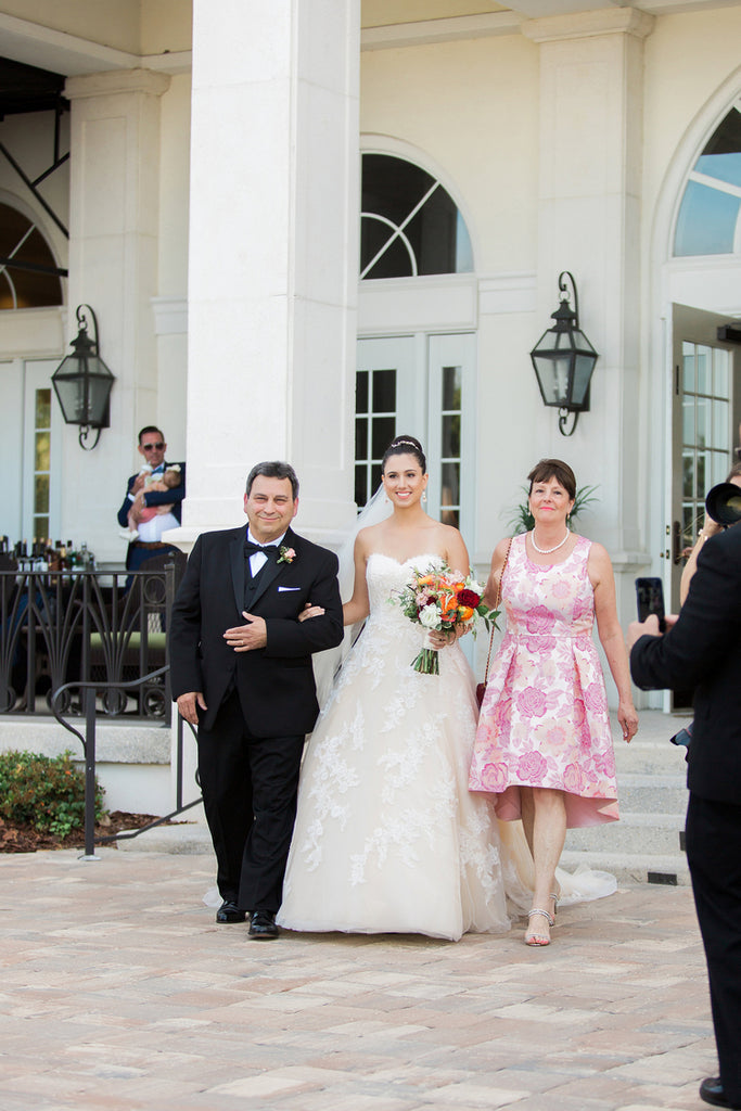 Bride walking down the aisle | Alexis and Michaels Wedding | Featured on Destination Wedding Details | Real Wedding blog
