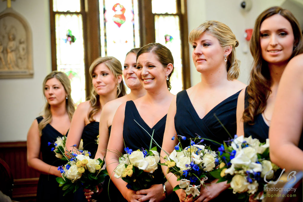 The smiles on these bridesmaids faces when they see the bride walking down the aisle is priceless! | Beautiful Navy Bridal Parties | Kennedy Blue | CLB Photography