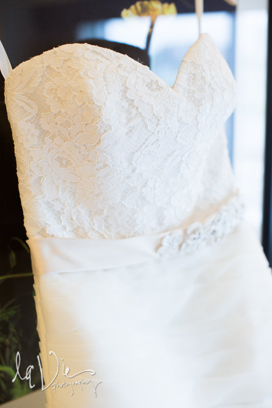 A gorgeous lace and organza wedding dress. | A Simply Chic Wedding Day | Your Something Blue
