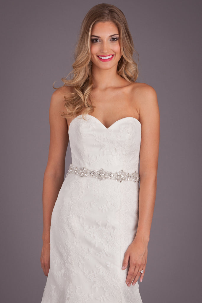 A fitted lace bridal gown that could flatter any figure! | Featured Style: A Lace Fit and Flare Wedding Dress