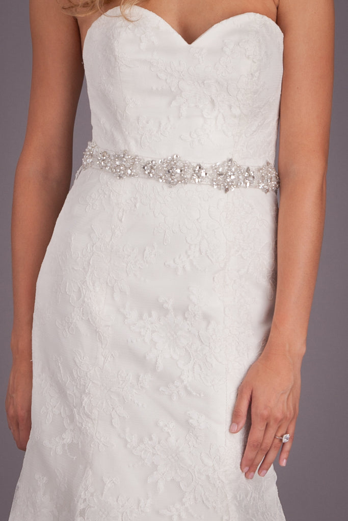 Fall in love with the elegant details of this lace bridal gown. | Featured Style: A Lace Fit and Flare Wedding Dress