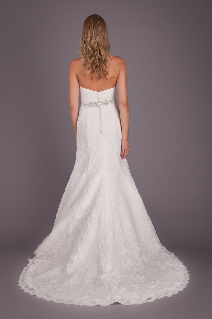 The back on this fitted lace bridal gown is simple, yet chic! | Featured Style: A Lace Fit and Flare Wedding Dress