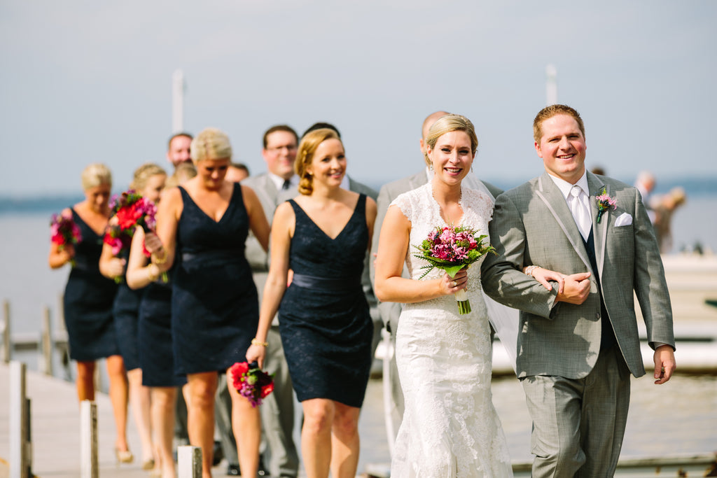 Cute walking candid photo of the wedding party! | Beautiful Navy Bridal Parties | Kennedy Blue | Tim Larsen Photography