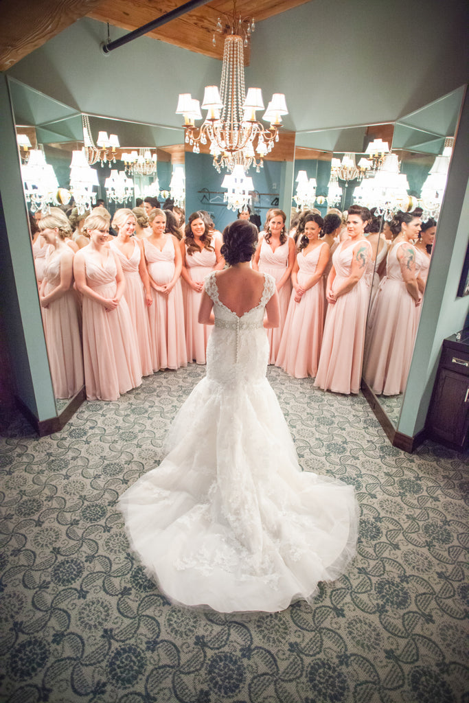 A stunning modern wedding with blush pink bridesmaid dresses.