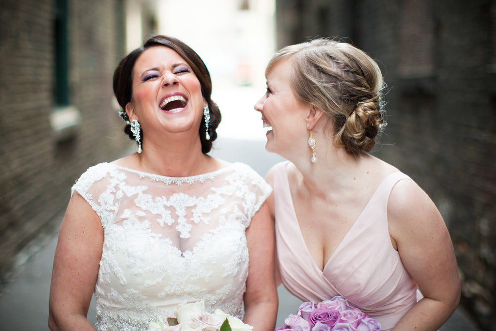 Bride and Bridesmaid Laughing Together
