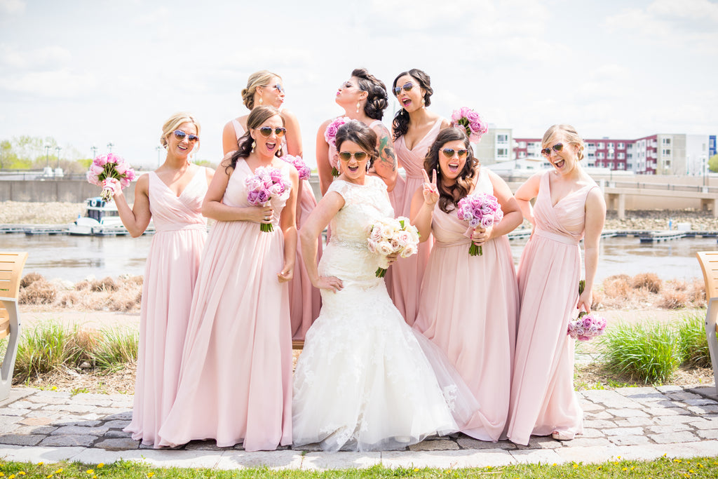 These heart-shaped sunglasses are adorable with the blush bridesmaid dresses!
