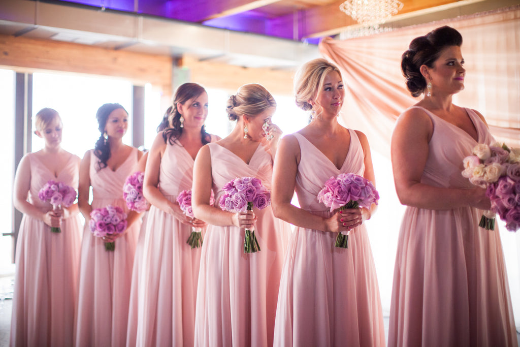 These blush bridesmaid dresses are definitely worth obsessing over. | A Modern Wedding Filled with Romance & Glamour - See the full gallery here!