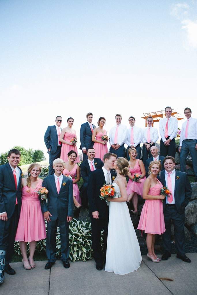A stunning bridal party with coral bridesmaid dresses and men's ties! | An Outdoor Wedding That's Simply Charming | Kennedy Blue
