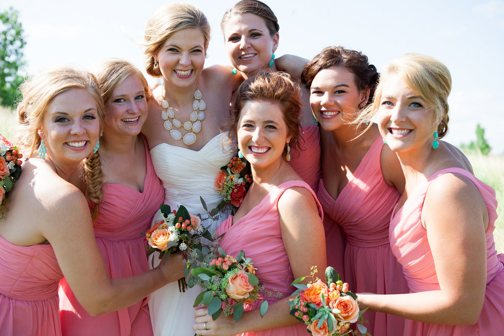 Kennedy Blue bridesmaid dresses in coral. | An Outdoor Wedding That's Simply Charming | Kennedy Blue