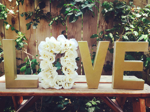 These paper mache 'LOVE' letters are such a cute addition to a bridal shower! | 52 Awesome Bridal Shower Ideas | Kennedy Blue | PrettySimplyStudio