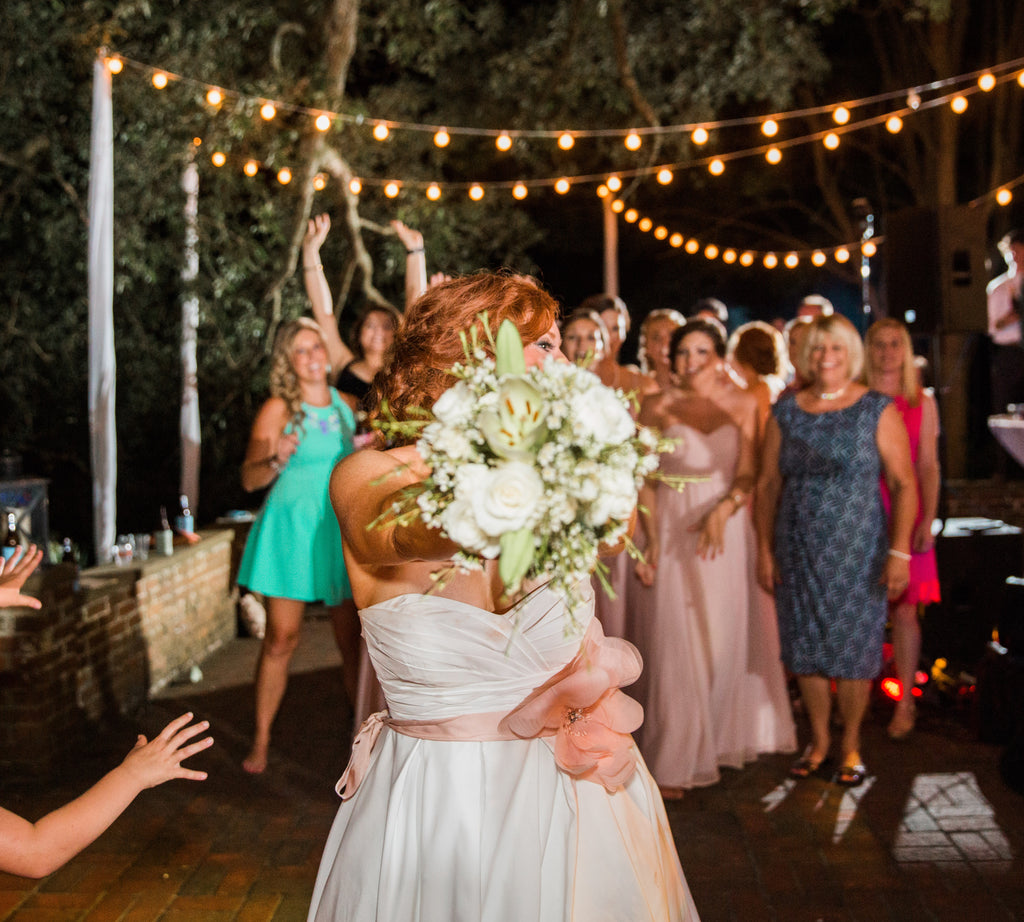 Cute photo of the traditional bouquet toss! | 52 Best Wedding Photo Ideas | Kennedy Blue | Jessica Roberts Photography