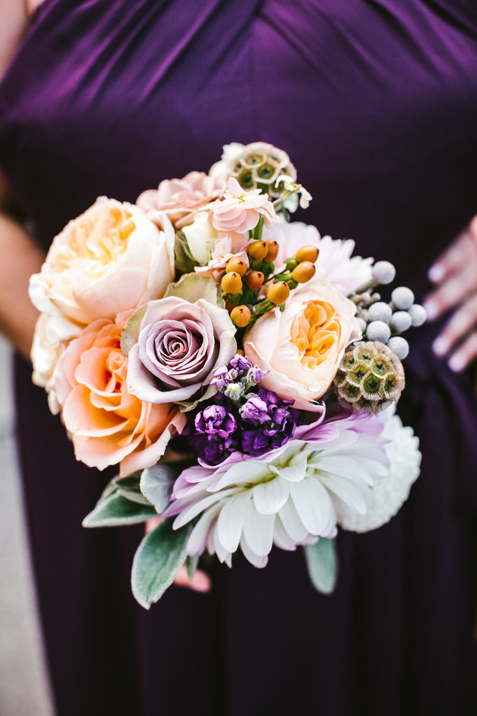 Pastel bridesmaid bouquet with a purple bridesmaid dress | A Chic Purple and Gold Pittsburgh Wedding