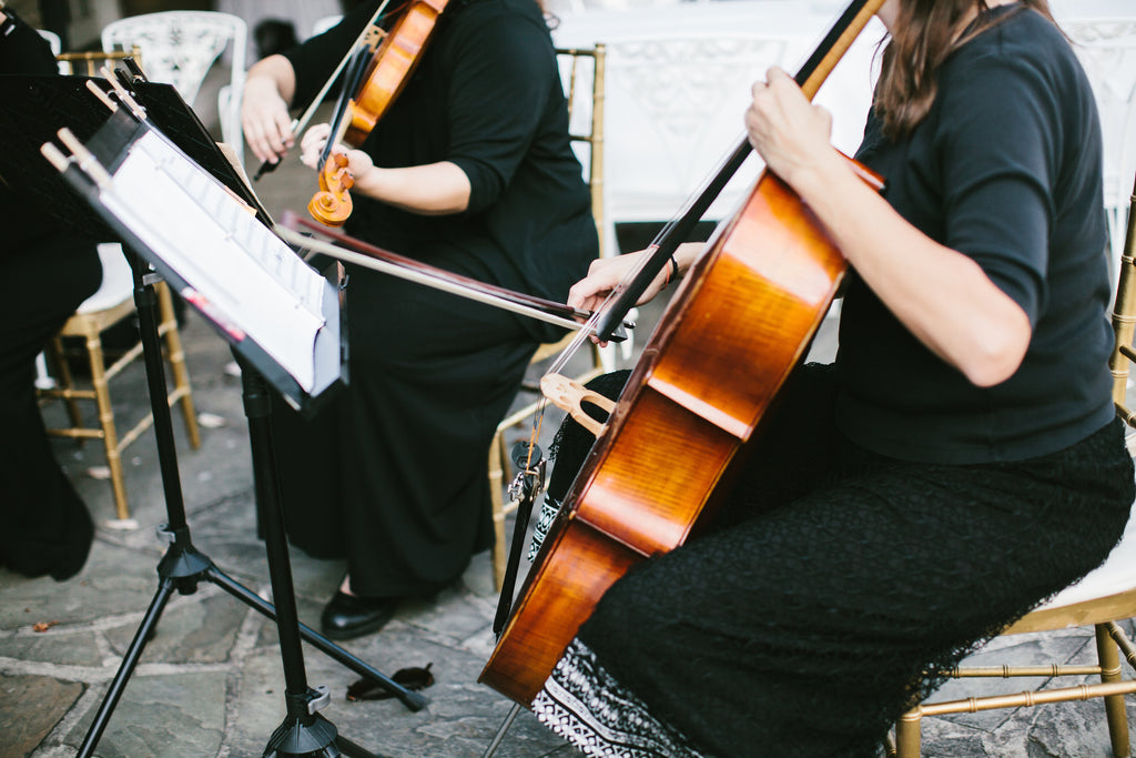 Live orchestra for the wedding ceremony music | A Chic Purple and Gold Pittsburgh Wedding