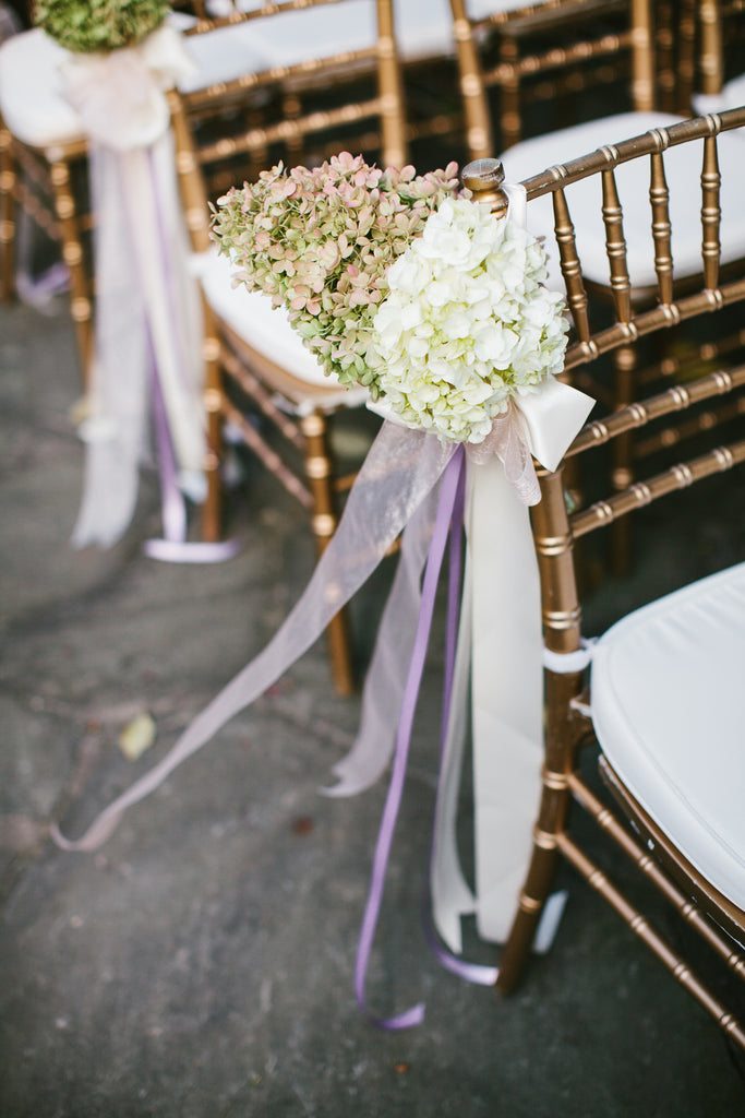 Flowers and ribbon were used for wedding ceremony decor | A Chic Purple and Gold Pittsburgh Wedding