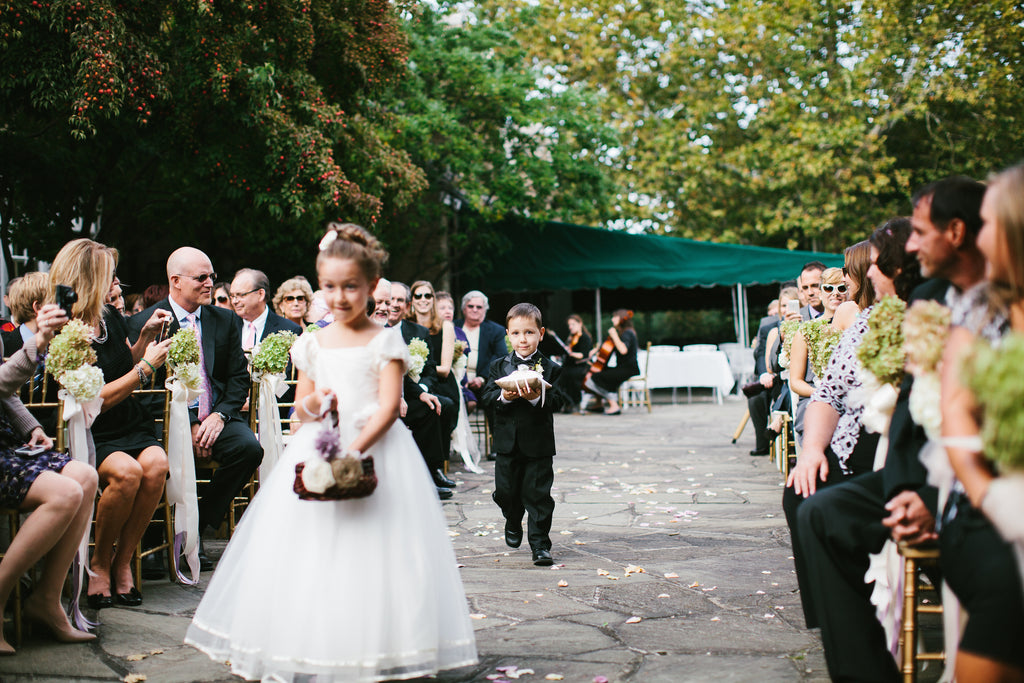 Flower girl and ring bearer at the wedding ceremony | A Chic Purple and Gold Pittsburgh Wedding