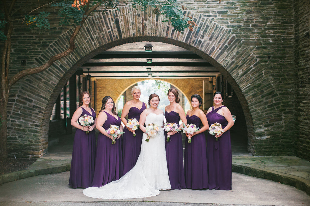 The bridal party wore eggplant purple bridesmaid dresses by Kennedy Blue | A Chic Purple and Gold Pittsburgh Wedding