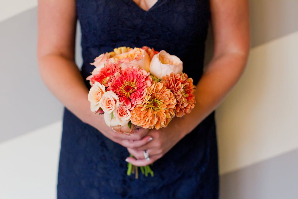 Beautiful orange bouquet against navy bridesmaid dress! | Beautiful Navy Bridal Parties | Kennedy Blue | Jodi Ann Photography