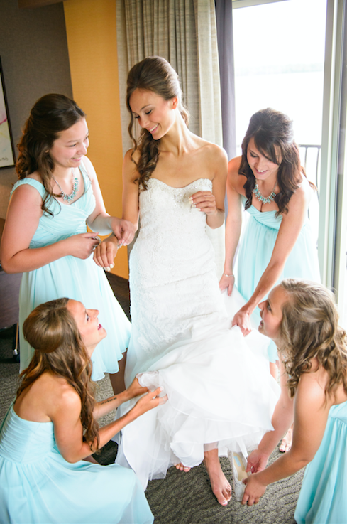 Bridesmaids helping the bride get ready! Definitely need a photo like this at your wedding! | 26 Photos To Take With Your 'Maids | Kennedy Blue | Purrington Photography
