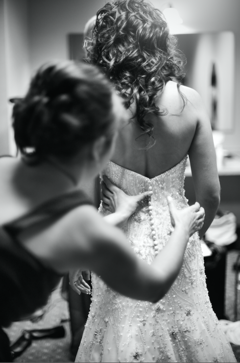 Bridesmaid helping the bride get ready! | 26 Photos To Take With Your 'Maids | Kennedy Blue | Sophia Mayrhofer Photography