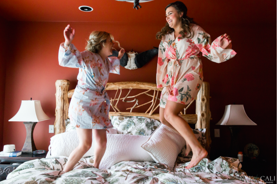 Cute photo of bride and bridesmaid jumping on the bed! | 26 Photos To Take With Your 'Maids | Kennedy Blue |