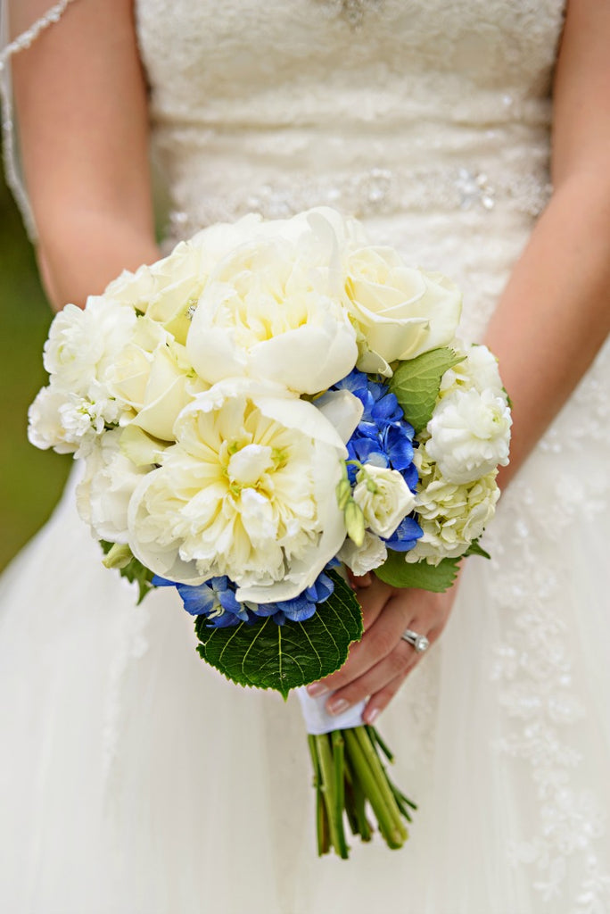 Blue accent flowers in wedding bouquet