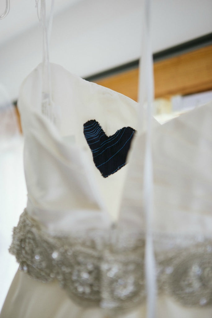 A simple sewn in fabric heart is the perfect touch for your 'something borrowed'