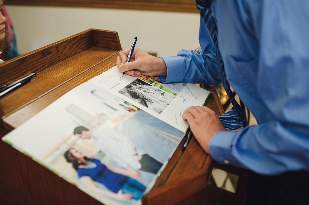 Looking for a guestbook idea? Jaimie and Jason created a photo book for guests to sign! | Kennedy Blue