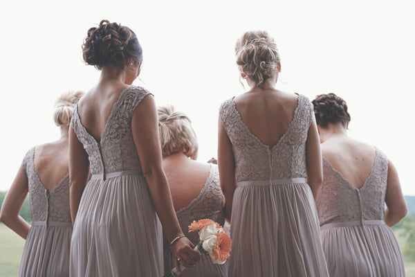 bridesmaids standing together | How to Plan Your Wedding Party for Your Gay Wedding