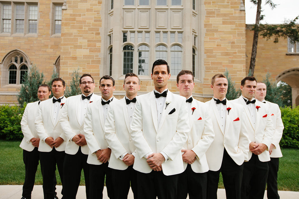 These groomsmen rocked the traditional all-white suit | Your Guide to Coordinating Groomsmen and Bridesmaids | Scott & Hannah Photography | Kennedy Blue