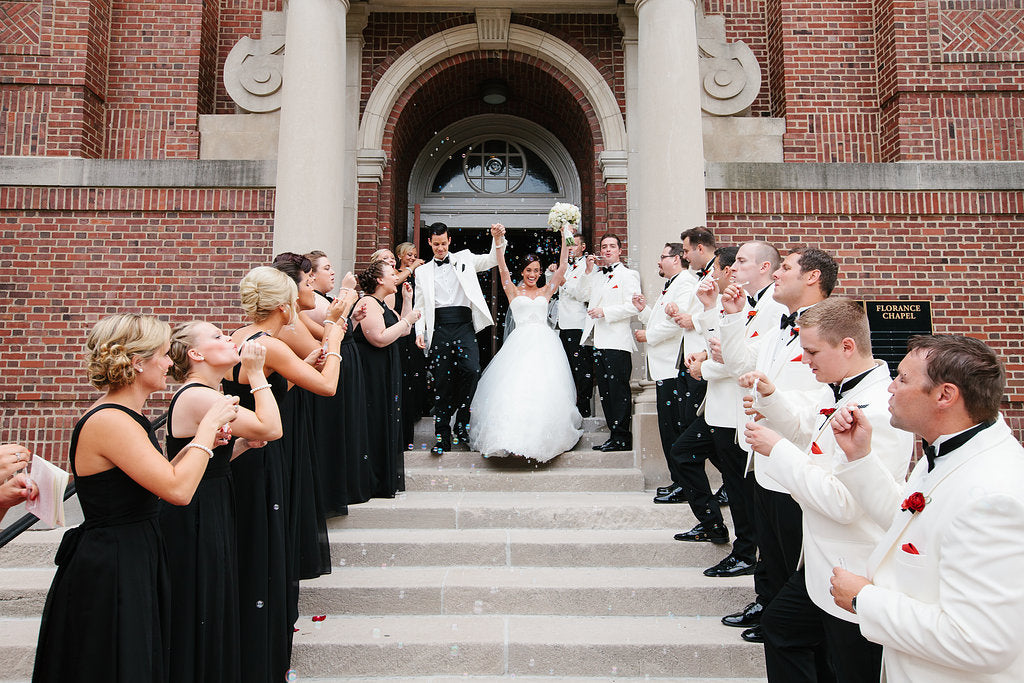 The couple's ceremony exit from the Chapel of St. Thomas Aquinas in St. Paul | A Timeless and Traditional Mansion Wedding