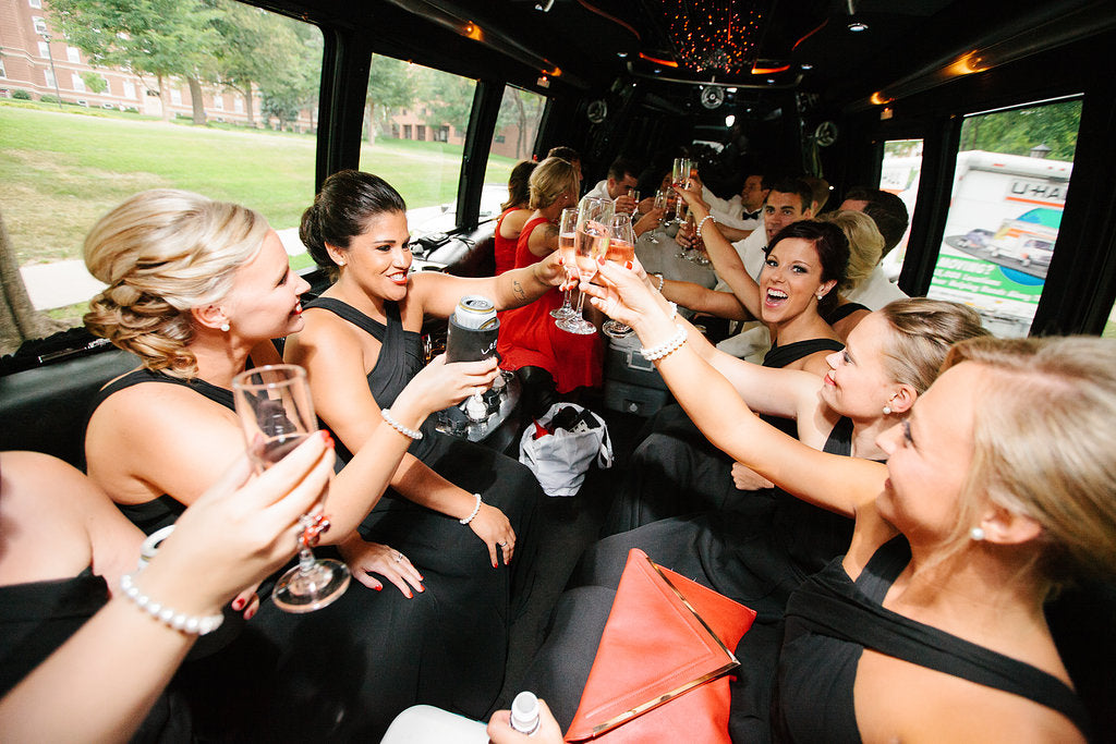 The bridal party had a party bus between the ceremony and reception. | A Timeless and Traditional Mansion Wedding