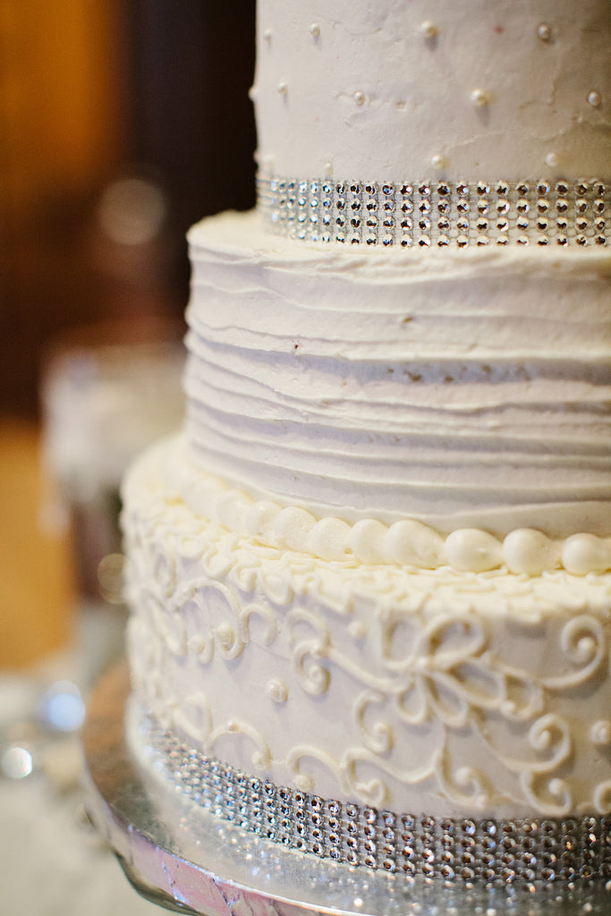 A simple and sparkly white wedding cake. | A Timeless and Traditional Mansion Wedding