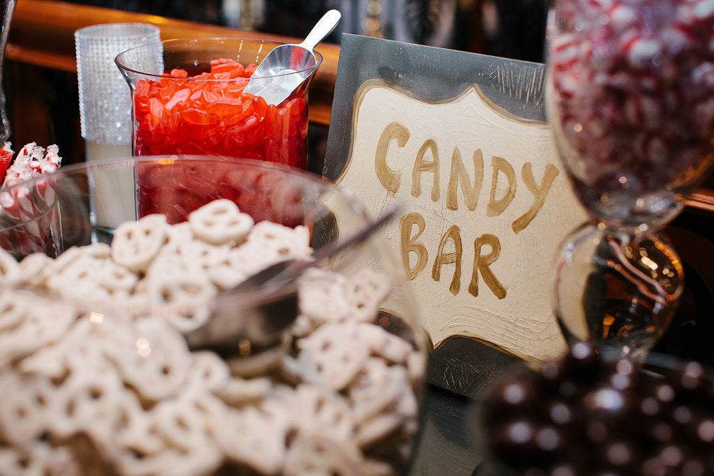 Set out a simple and chic candy bar for your Halloween-themed wedding!
