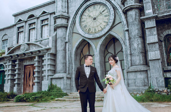 two couples standing in front of a church | How to Find a Wedding Officiant