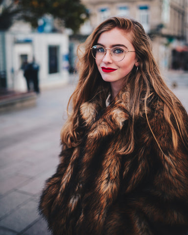 girl wearing faux fur | Best Backyard Wedding Ideas