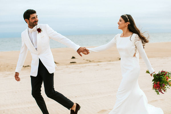 bride and groom on beach | Ivory Bridesmaid Dresses