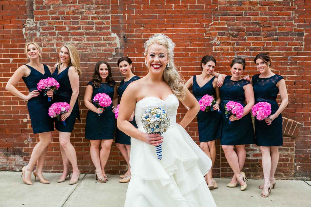 A fun wedding photo of the bride with her bridesmaids | A Blue and Pink Rock 'n Roll Wedding