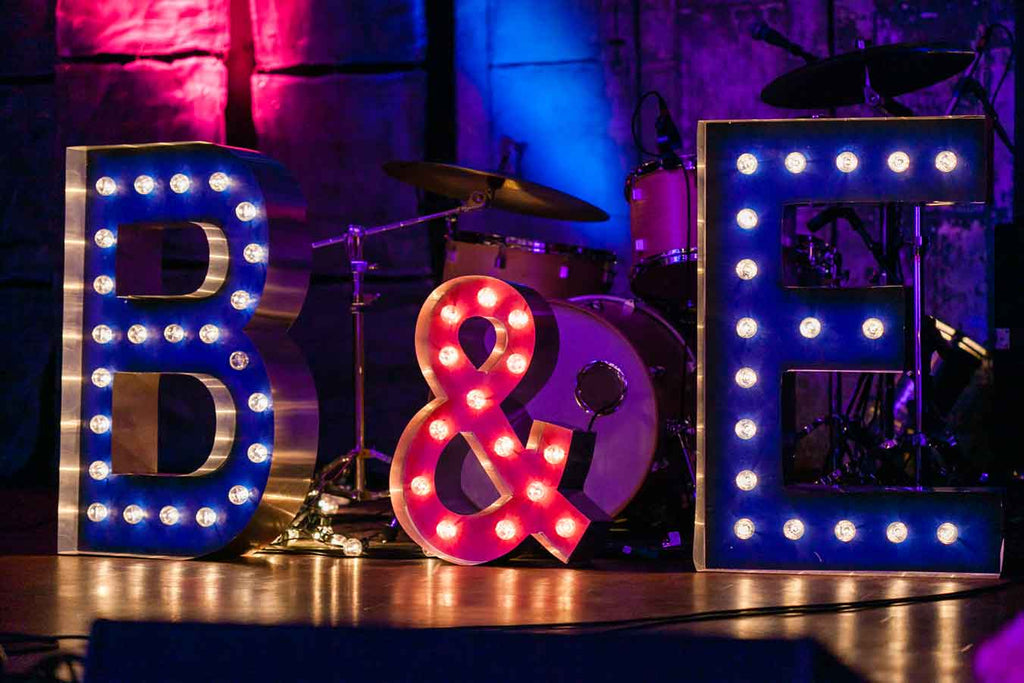 Marquee signs used as wedding decor | A Blue and Pink Rock 'n Roll Wedding