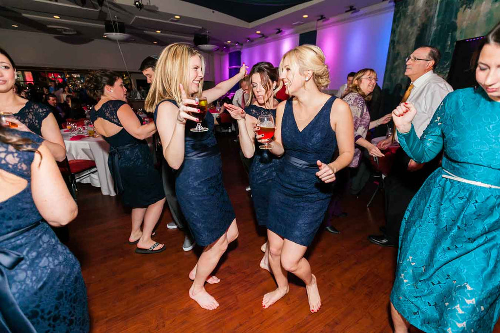 The bridesmaids on the dancefloor | A Blue and Pink Rock 'n Roll Wedding