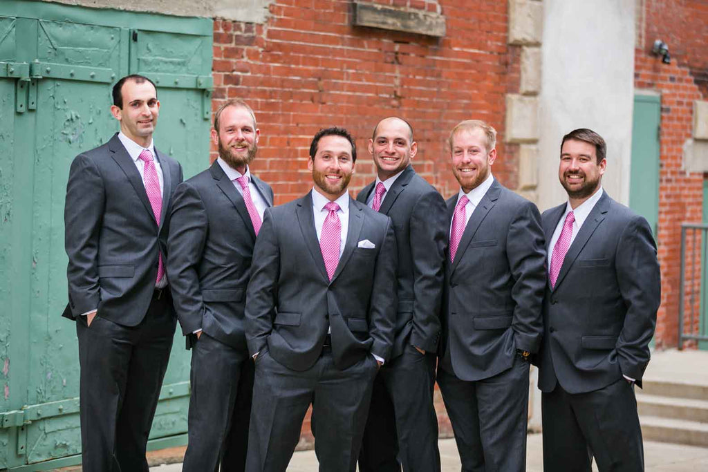 The groomsmen look handsome in pink! | A Blue and Pink Rock 'n Roll Wedding
