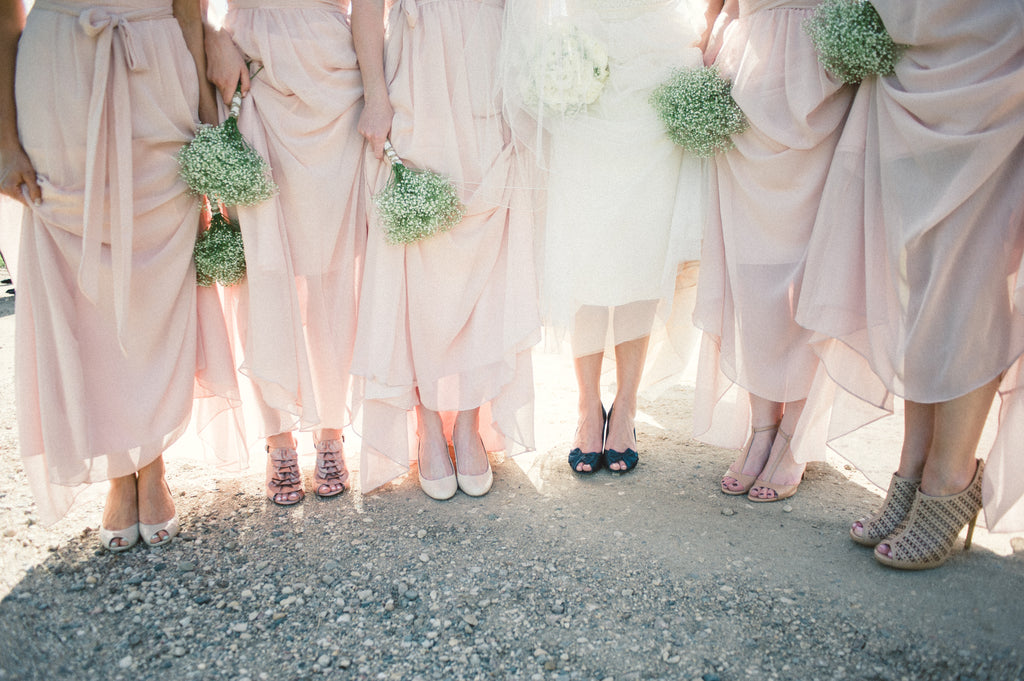 Blush pink bridesmaid dresses with trendy, mismatched shoes.