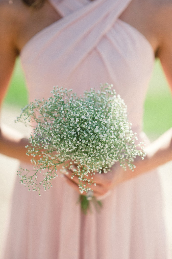 A baby's breath bouquet with blush pink bridesmaid dresses is such a soft and sweet combination.