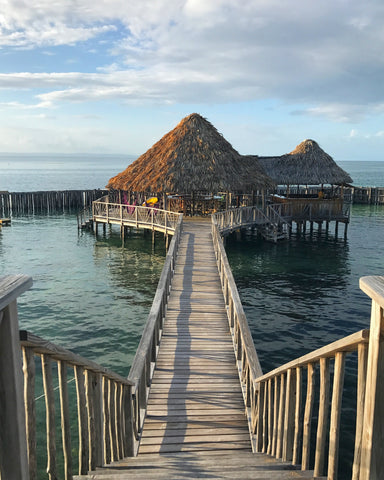 hut on the water in Belize | The Best Destination Wedding Locations