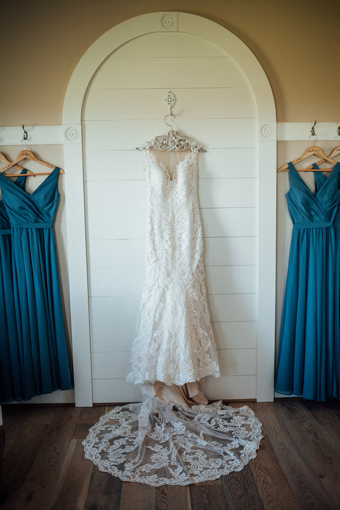 Wedding-Gown-Hanging-Emily-Caleb-Featured-BrideStory-Real-Wedding