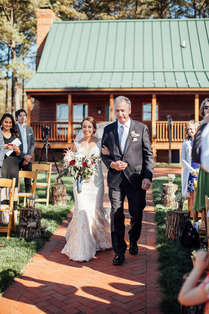 Bride-walking-down-aisle-Emily-Caleb-Featured-BrideStory-Real-Wedding